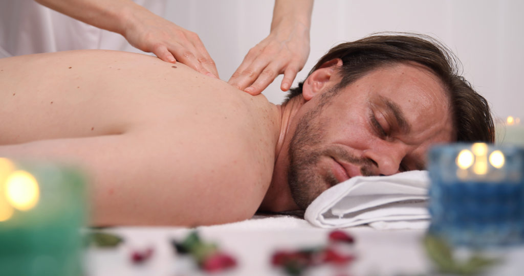 man being massaged