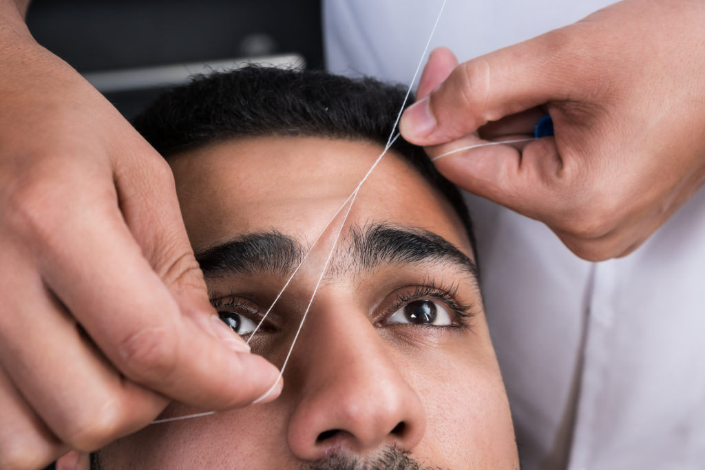 man's eyebrows threaded